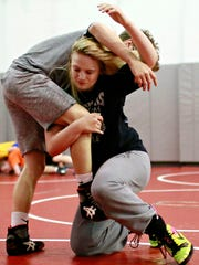 Tiffani McNelis, 14, front, of Stewartstown, and Mason Lewis, 15, of Dover, partner on drills during Modern Day Gladiators Wrestling Club practice at Dover Area High School in Dover, Thursday, May 18, 2017. Dawn J. Sagert photo