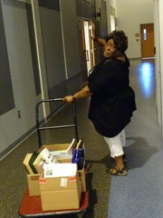 Regina Kanary, a private music teacher from Oak Harbor, wheels out a treasure trove of music from the free Music Give-Away at Terra State Community College.