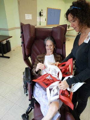 Creative arts facilitator, Sharyn Alexander, right, works with Donna Deberti, a resident of The Center for Neurodegenerative Care at ArchCare at Ferncliff in Rhinebeck, on an art therapy project.