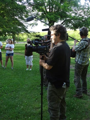 Joe Berlinger, director and executive producer for a planned series on the area's missing women, looks on at a vigil in Yoctangee Park in June.