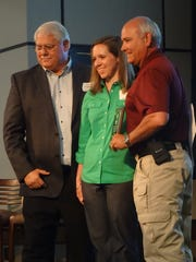 Joe Holyfield, Courtney Hornsby and Sheriff Jay Russell.