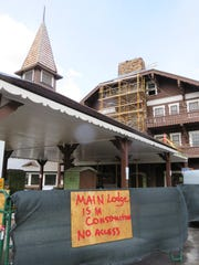 Guests and visitors have been blocked from using the main entry to the historic Many Glacier Hotel this year while construction workers complete the final stage of remodeling and utility improvement work.