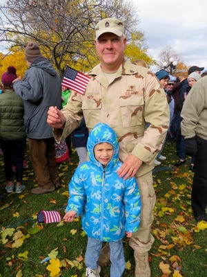 "Vermont Army Guard Sgt. 1st Class Michael Heth, of Georgia brought his son Liam, 6, to the Veterans Day event in St. Albans, ""because it is important for (Liam) to see the community come together to support veterans,"" Heth said."