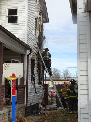 Firefighters work to contain a fire at 329 Clay St. Tuesday morning in Chillicothe, Ohio.