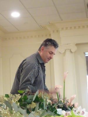 Clinton Downing arranges a floral design for the Monroe Garden Club.
