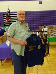 George Hallarn stands with his Bloom-Carroll FFA jacket at the district showcase Tuesday evening in the middle school gym.