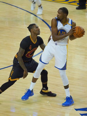 Kevin Durant (35) is defended by Iman Shumpert (4) during the first half in Game 2 of the 2017 NBA Finals.