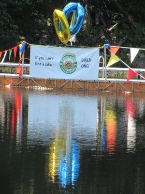 Banner on float at the waterfront at Camp Glen Gray