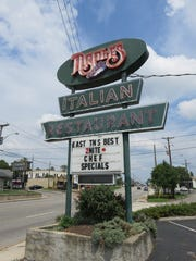 Look for this vintage sign to locate Naples Restaurant