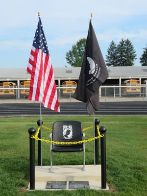 This chair, donated by the Sons of the American Legion 257, will remain empty in remembrance of POW and MIA soldiers. The POW-MIA Chair of Honor is located by the flag pole and score board at Redbird Stadium in Loudonville.