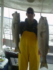 Mark Rosen with a pair of striped bass he landed on