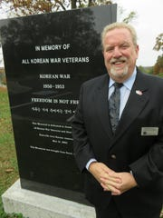 East Tennessee Veterans Cemetery director Kevin Knowles in front of a Korean War memorial.