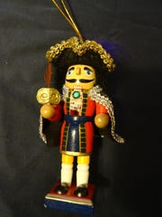 An ornament depicting a nutcracker purchased in Munich. The nutcracker's mouth opens and closes.