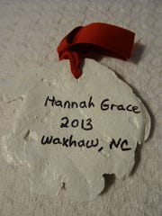 "A dough ornament made by Leigh Grainger with Hannah Grace's ""help""."