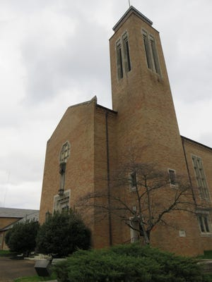 The church building features a bell tower.