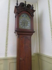 This tall clock on the stairway resembles one in the