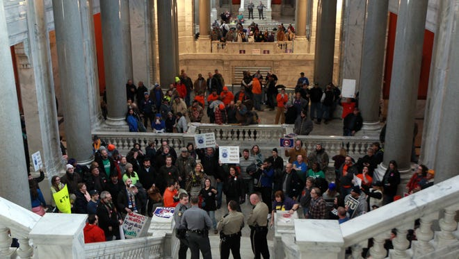 Union workers protest in the state capitol against the right-to-work bill and other labor union bills as the House and Senate work in their chambers at the Kentucky State Capitol in Frankfort, Kentucky.    January 7, 2017