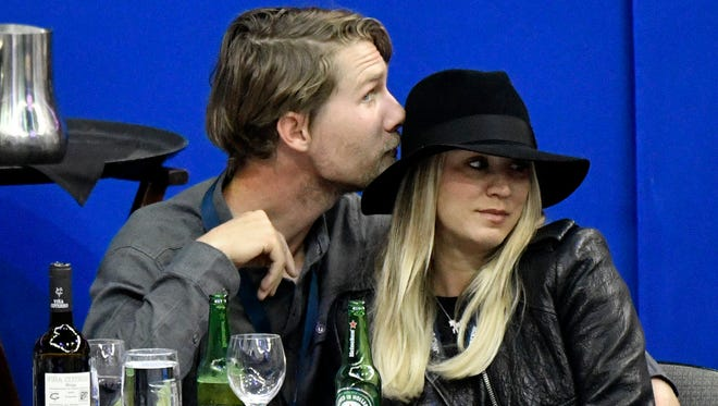 Cameras caught Kaley Cuoco and boyfriend Karl Cook snuggling at an equestrian competition Friday in Omaha, Neb.
