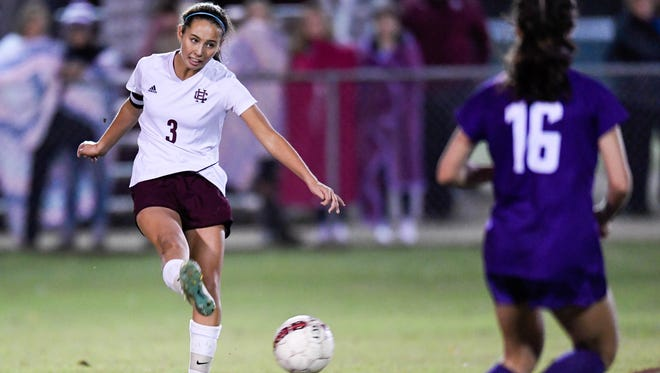 Henderson's Marissa Sauer (3) passes the ball during the first round of the Girls State Soccer Tournament played at Colonel Field in Henderson Tuesday, October 24, 2017.