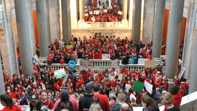 Kentucky School Teacher and their supporters protest in the capital rotunda to show their displeasure with the pension reform bill at the State Capital in Frankfort, Kentucky,       April 2,  2018.