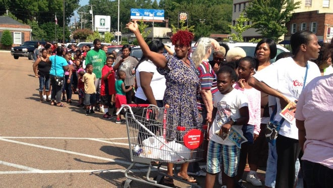 People stood in line Saturday morning for two hours to get a free backpack full of school supplies for their children in the parking lot of CVS on North Highland Avenue. The backpacks were given away by Avalon Hospice.
