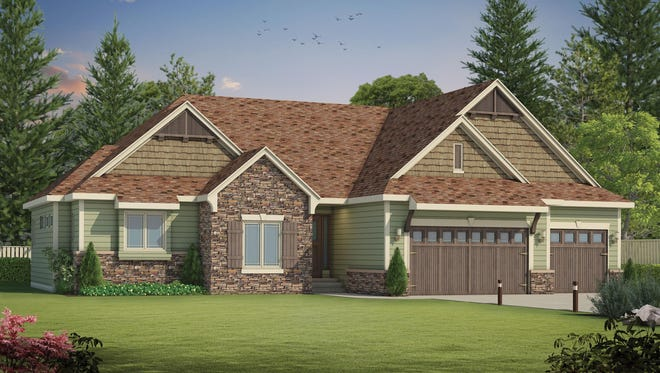 Stone and shake siding contribute classic curb appeal on the exterior.