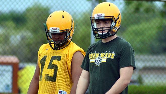 Collin Minor (right) will return as Gallatin's team's starting quarterback this fall, while Malik Cook (15) was one of several players getting reps at tailback during spring practice.