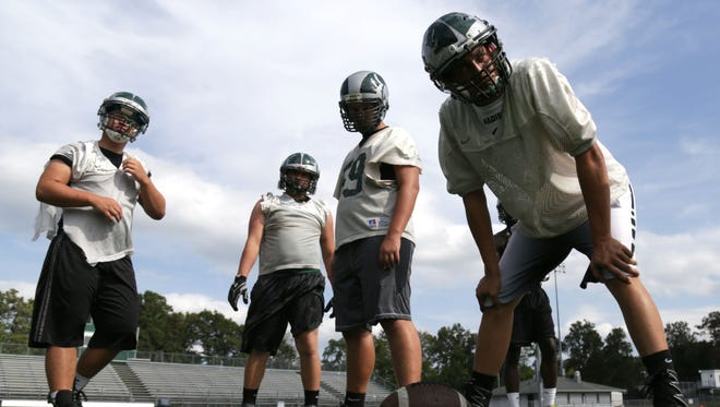 Madison High School varsity football players practice on Wednesday to prepare for their first game of the season at Shelby on Thursday.