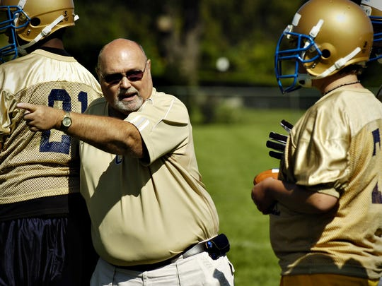 St. Cloud Cathedral football coach Dean Taylor offers