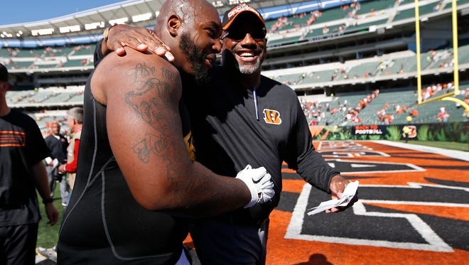Bengals defensive tackle Devon Still (left) is congratulated by tight ends coach Jonathan Hayes after Sunday's 24-10 win against the Atlanta Falcons at Paul Brown Stadium.