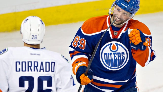 Edmonton Oilers center Sam Gagner celebrates a first-period goal on Saturday. He later left the game with a broken jaw.