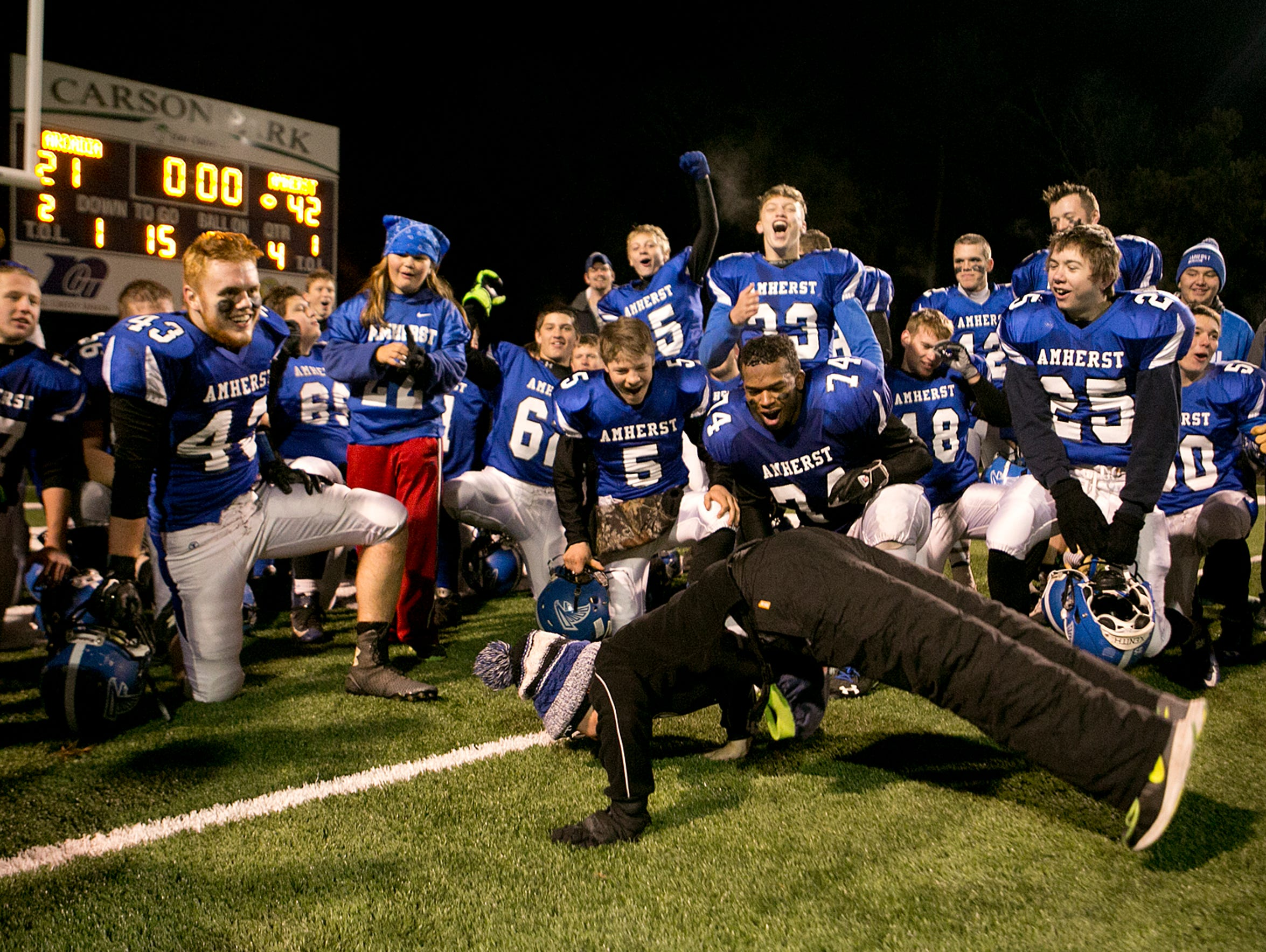 Jack Spadoni, 11, does the worm for the Amherst football