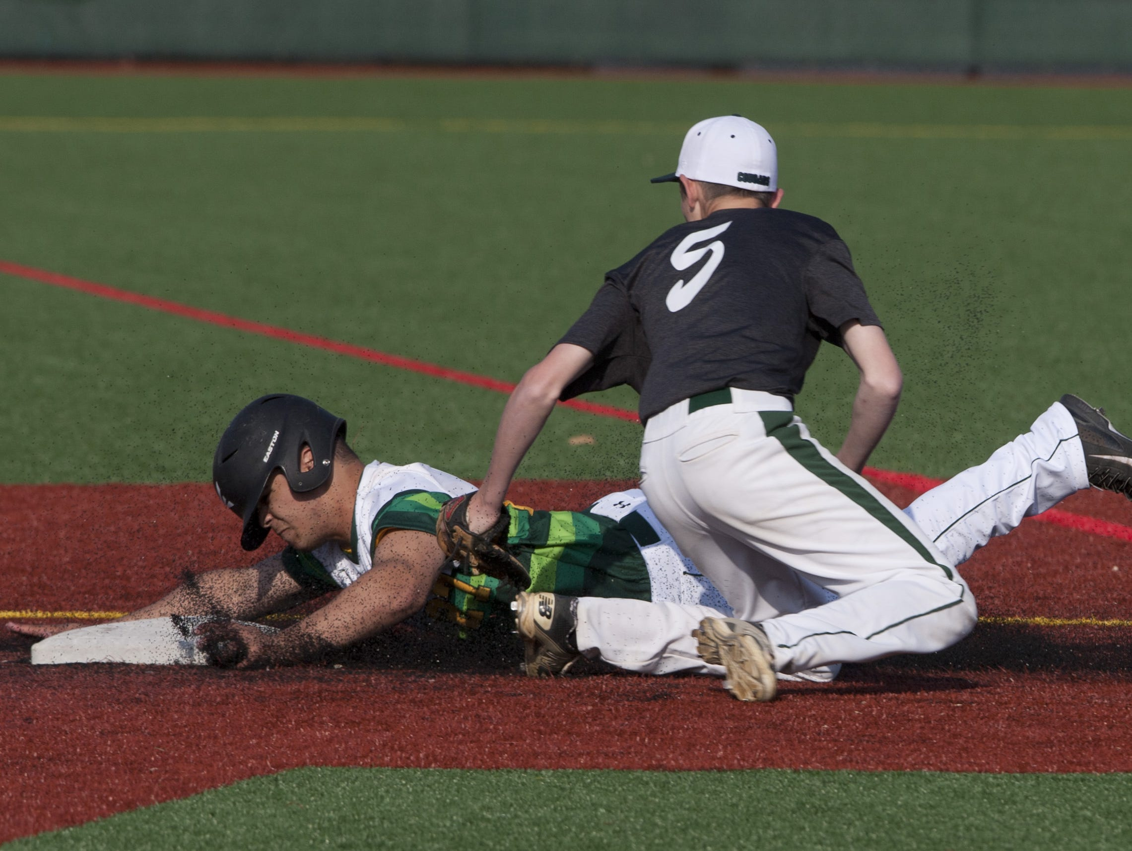 Colts Neck's Tim Cavrak puts the tag on Red Bank Catholic's Dom Caraballo trying to steal second in the fourth inning.
