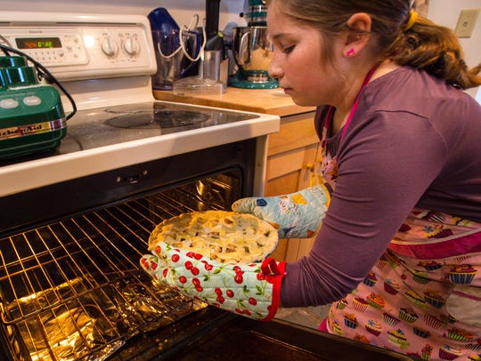 Adelie Tebbetts makes an apple pie at home in Cabot