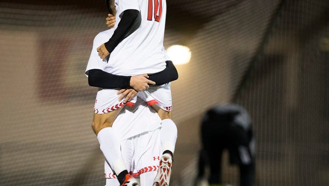 Immokalee's Raymundo Cervantes hoists Ulises Soto (10) into the air in celebration after Cervantes scored the second of Immokalee's two goals in the first half of action against Mariner during the Class 3A regional quarterfinal Wednesday, Feb. 1, 2017 in Immokalee. Immokalee took a 2-0 lead into halftime.