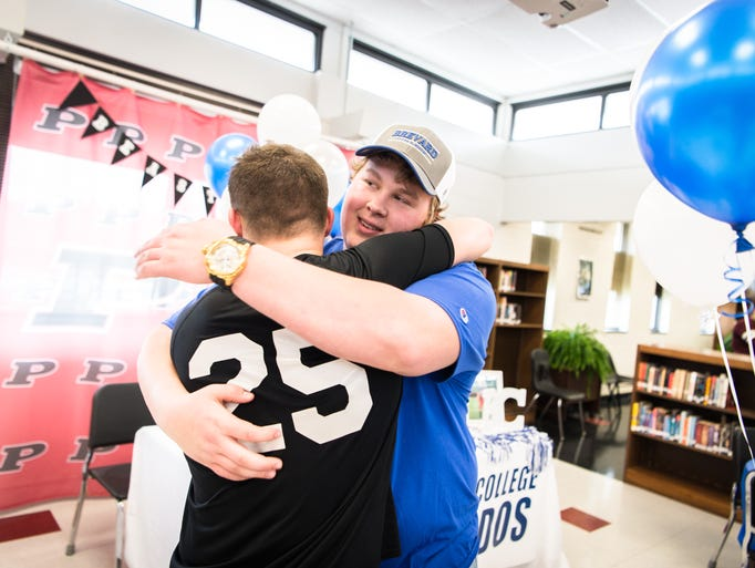 Ashton Hill, of Pisgah High School embraces a friend