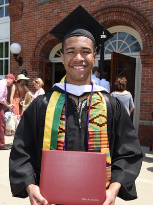 Kyle Tam of the City of Poughkeepsie, with his degree from Vassar College.
