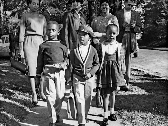 "October 3, 1961 - Thirteen black first graders entered four of Memphis' previously all-white schools including Bruce School these students were attending. It marked the beginning of the Board of Education's ""good faith"" integration plan for the city's public school system. The children transferred to Bruce were from left; Harry Williams, 6, Michael Willis, 5, and Dwania Kyles, 5. Some 200 police guarded Bruce, Springdale, Rozelle and Gordon schools as school officials surprised the city with the first black first-graders that October morning. Willis, son of prominent black attorney A.W. Willis, later changed his name to Menelik Fombi."