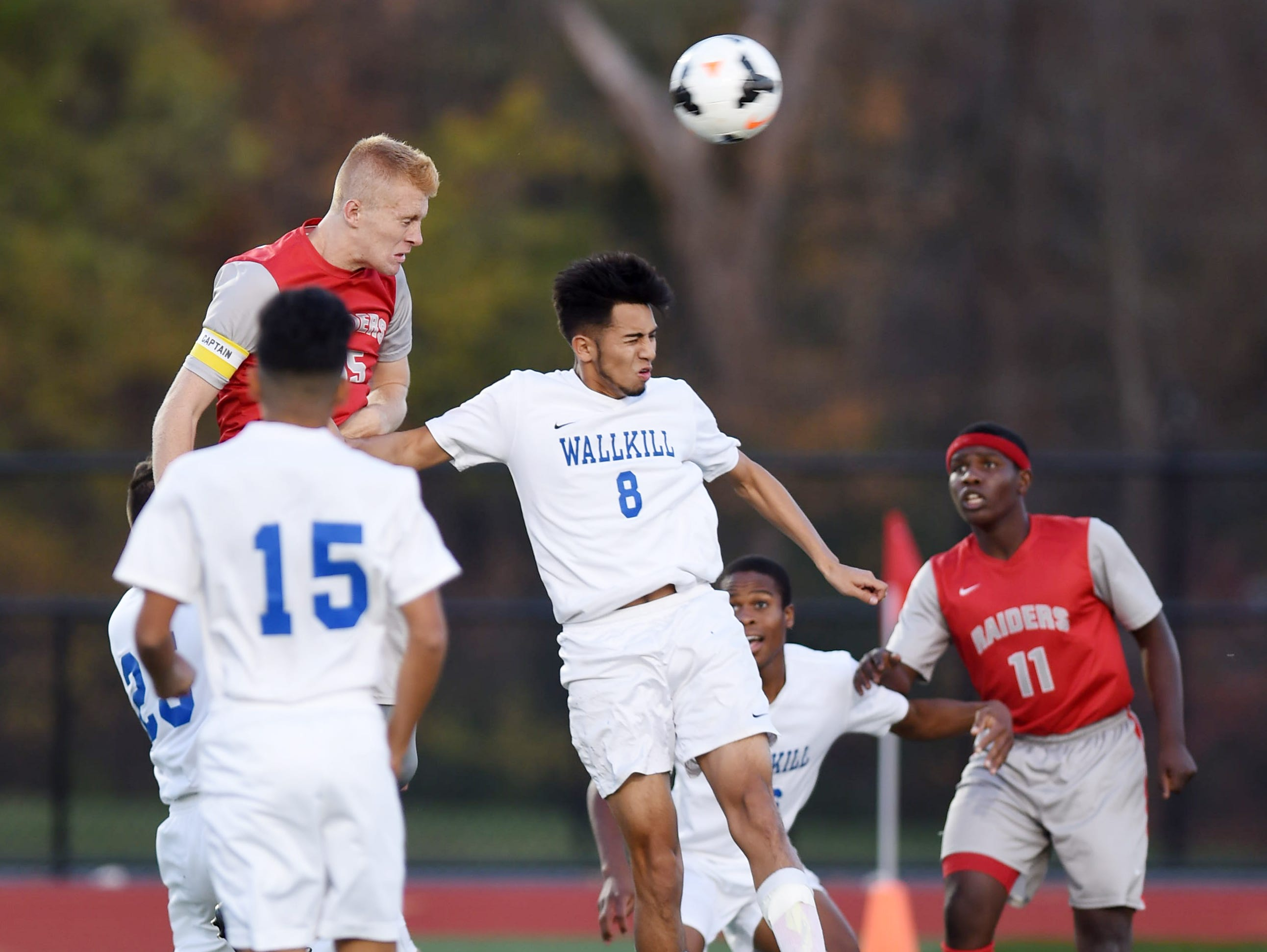 Red Hook's Dennis Hare headers the ball into the goal past Wallkill's Jeffrey Arenas during Tuesdays Mid-Hudson Athletic League Semi-Final held in Staatsburg.