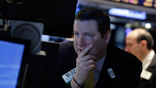 Specialist Gregg Maloney works on the floor of the New York Stock Exchange.