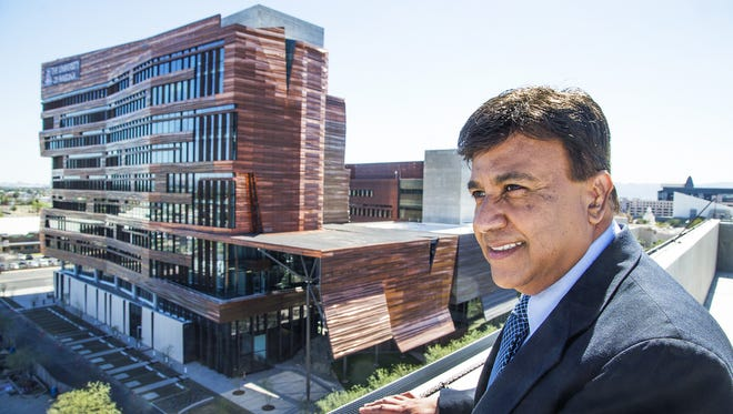 Dr. Kenneth Ramos says the University of Arizona medical school in downtown Phoenix has taken steps to shore up diversity recruitment for students, faculty and staff. Ramos, the interim dean, overlooks the new Biomedical Sciences Partnership Building that opened Feb. 23, 2017, in downtown Phoenix.