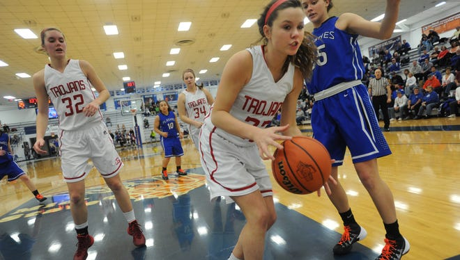 Center Grove's Jessica Norris tries to stay inbounds going after a rebound as teammate Alison Line and Franklin Central's Rachel Titzer watch in the fourth quarter as Franklin Central defeated Center Grove 48-40 in the opening round of Girls Basketball Section 13 at Whiteland Community High School Tuesday February 11, 2014.