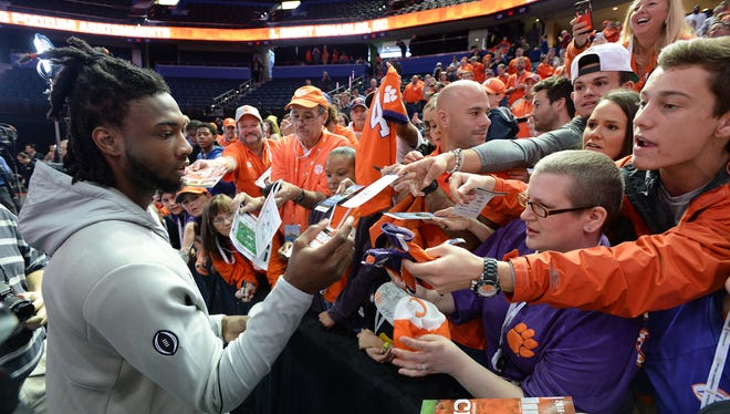 Clemson wide receiver Mike Williams signs autographs for Clemson fans during the Tigers National Championship Media Day in Tampa on Saturday, January 7, 2017.