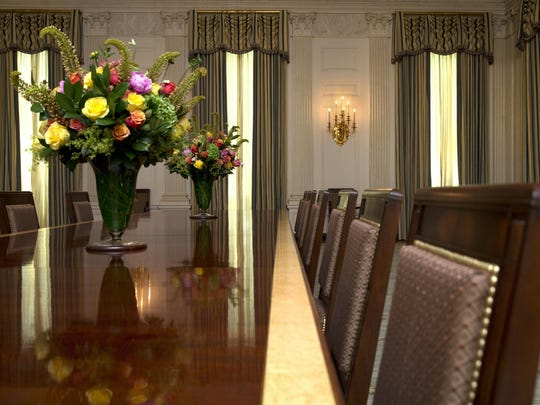 The State Dining room of the White House has been refurbished with new arm chairs, side chairs, and draperies suspended from carved and gilded poles, all of which were selected with the approval of the Committee for the Preservation of the White House in consultation with first lady Michelle Obama, as seen at the White House Tuesday, July 7, 2015 in Washington. (AP Photo/Jacquelyn Martin)