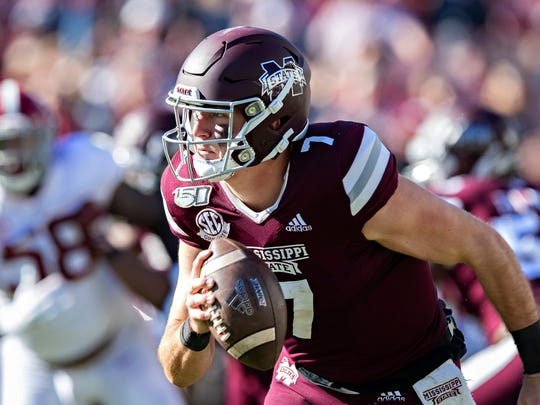 FAYETTEVILLE, AR - NOVEMBER 9:   Tommy Stevens #7 of the Mississippi State Bulldogs rolls out to avoid the rush during a game against the Alabama Crimson Tide at Davis Wade Stadium on November 16, 2019 in Starkville, Mississippi.  The Crimson Tide defeated the Bulldogs 38-7.  (Photo by Wesley Hitt/Getty Images)