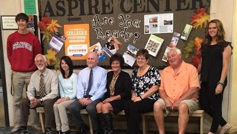 From left to right:  Regis student Sam Nieslanik, Regis counselors Mike Bauer, Selena Galindo, Aspire liaison Dave Schumacher, Regis Aspire coordinator Patti Keudell, Aspire mentors Carolyn Lulay, Tom Lulay, and student Emma Van Veen.