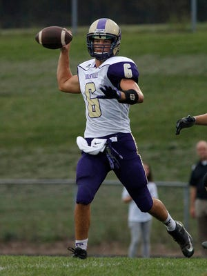 Fowlerville quarterback Nick Semke throws a pass against Portland Friday, Sept. 9, 2016, in Portland, Mich. Portland won 33-0.