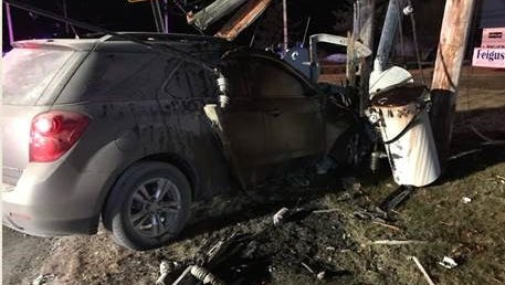 A car caught fire after crashing into a pole when the pole and three transformers fell on it, police said.