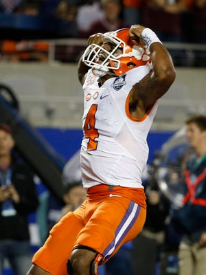 Clemson Tigers quarterback Deshaun Watson (4) celebrates as he scores a touchdown against the Virginia Tech Hokies during the second half of the ACC Championship college football game at Camping World Stadium.