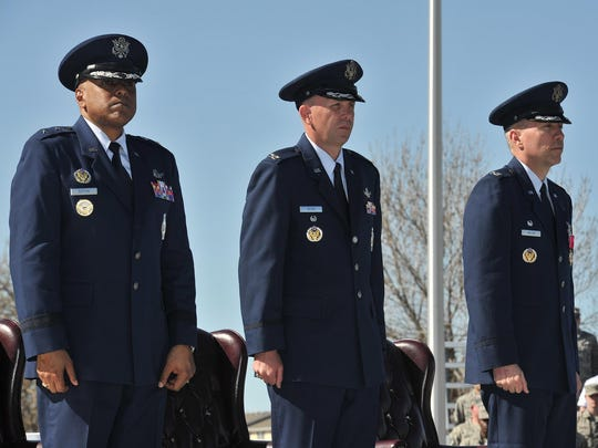 Maj. Gen. Anthony J. Cotton, 20th Air Force commander, Col. Ronald G. Allen Jr., 341st Missile Wing commander, and Col. Tom Wilcox, previous 341st commander, stand for the Air Force song at the end of the 341st change of command ceremony Tuesday at Malmstrom Air Force Base.